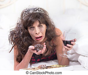 Sobbing Woman in Tiara Drinking Wine and Cramming Chocolates in Bedroom