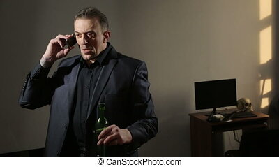 sober angry man talking on the phone. drunk businessman