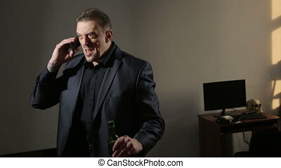 sober angry man talking on the phone. drunk businessman in...