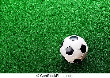 Soccer ball against artificial turf. Studio shot. Copy...