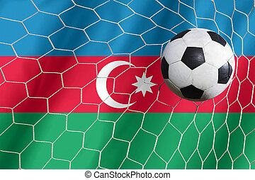 Soccer ball and national flag of Azerbaijan lies on the green grass