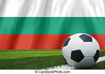 Soccer ball and national flag of Bulgaria lies on the green grass