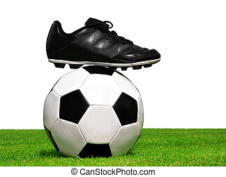 soccer ball and shoes in grass isolated on white background
