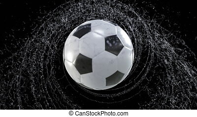 Soccer ball emitting whirl of water drops, with rgb mask, 4k...