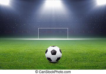 Soccer ball, goal, spotlight - Soccer ball on green stadium,...