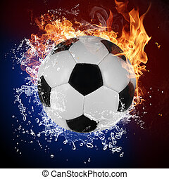 Soccer ball in fire flames and splashing water