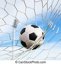 soccer ball in goal net