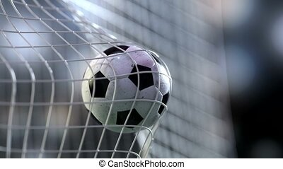soccer ball in goal net with slowmotion. Slowmotion football...