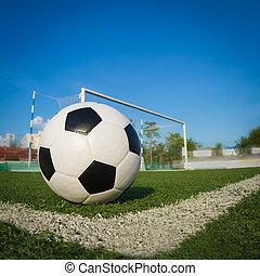 Soccer ball in goal, success concept