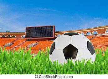 soccer ball in grass on stadium