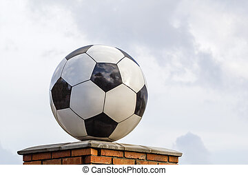 Soccer ball made of marble, decorative architectural element