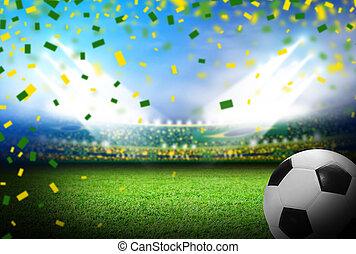 Soccer ball on football field in brazil stadium with light