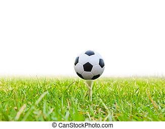 soccer ball on golf tee isolated