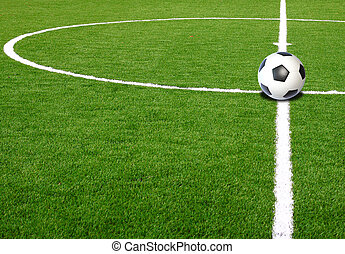 Soccer ball on green field