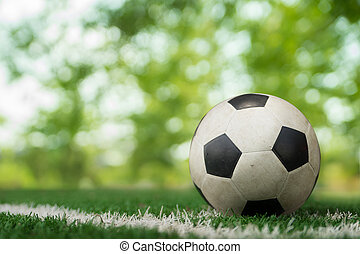 soccer ball on soccer field and bokeh background