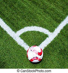 Soccer ball on the field corner