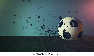slow motion soccer ball with peaces of dirt