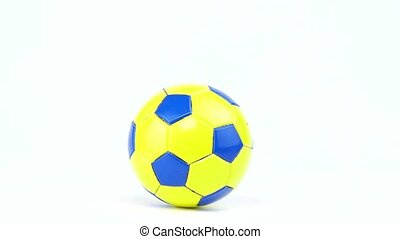 Soccer ball spinning on a white background.