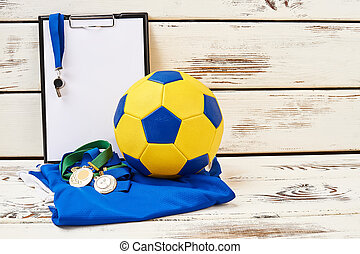 Soccer ball, uniform and clipboard