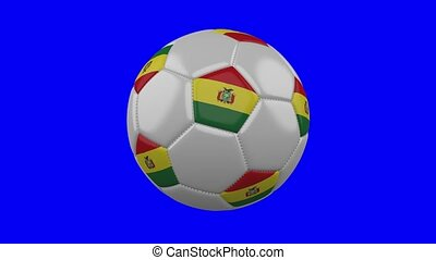 Soccer ball with Bolivia flag rotates on blue chroma key background, loop