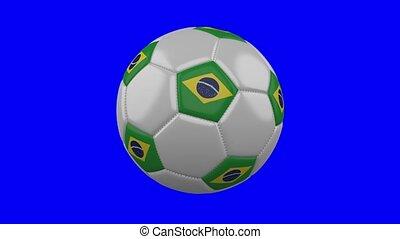 Soccer ball with Brazil flag on blue chroma key background, loop