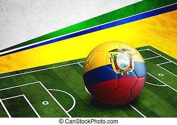 Soccer ball with Ecuador flag on pitch