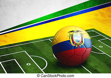 Soccer ball with Ecuador flag on pitch