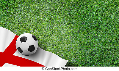 Soccer ball with England flag on green grass in stadium with copy space