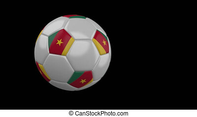 Soccer ball with flag Cameroon, slow motion blur, 4k footage with alpha channel