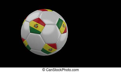Soccer ball with flag of Bolivia flies past camera, slow motion, alpha channel