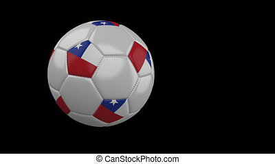 Soccer ball with flag of Chile flies past camera, slow motion, alpha channel