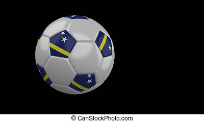 Soccer ball with flag of Curacao flies past camera, slow motion, alpha channel