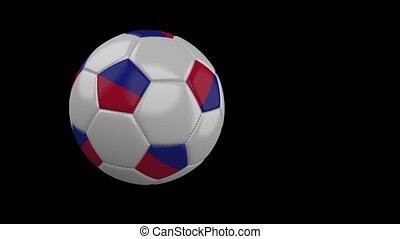 Soccer ball with flag of Haiti flies past camera, slow motion, alpha channel