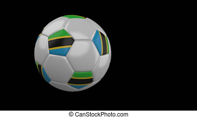 Soccer ball with flag Tanzania, slow motion blur, 4k footage...