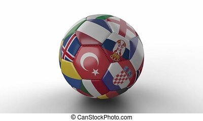 Soccer ball with flags of European countries rotates on white surface, loop 3
