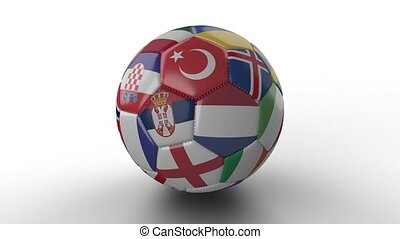 Soccer ball with flags of European countries rotates on white surface, loop
