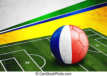 Soccer ball with France flag on pitch