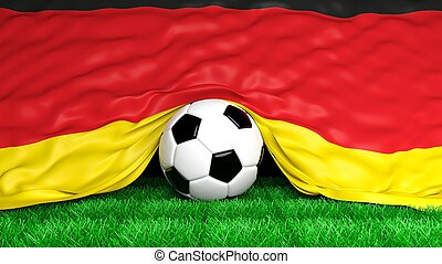 Soccer ball with German flag on football field closeup
