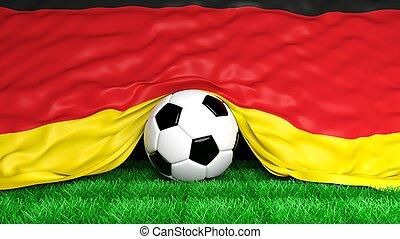 Soccer ball with German flag on football field closeup
