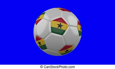 Soccer ball with Ghana flag on blue chroma key background, loop