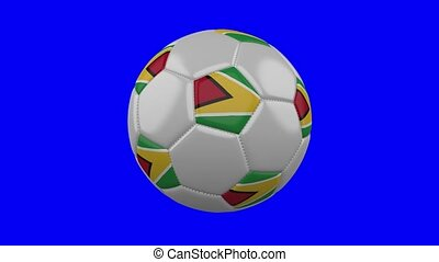 Soccer ball with Guyana flag on blue chroma key, loop