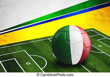 Soccer ball with Italy flag on pitch