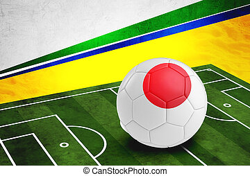 Soccer ball with Japan flag on pitch