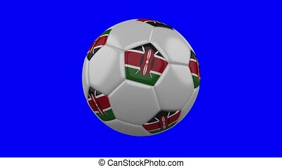 Soccer ball with Kenya flag on blue chroma key background,...
