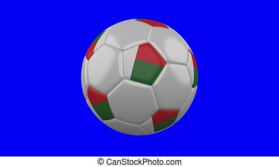Soccer ball with Madagascar flag on blue chroma key background, loop
