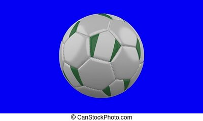 Soccer ball with Nigeria flag on blue chroma key background, loop