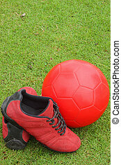 Soccer ball with sneakers