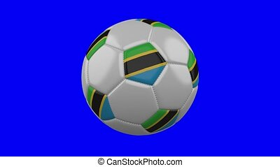 Soccer ball with Tanzania flag on blue chroma key background, loop