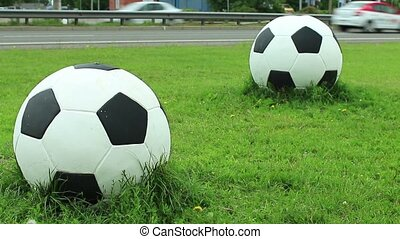 Soccer balls by the road