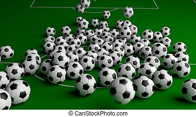 Soccer balls on green grass